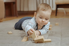 Cute little baby boy playing on the floor Stock Photography