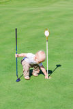 Cute little baby boy playing golf on a field Royalty Free Stock Photography