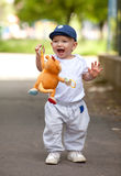 A cute little baby boy playing. In the park Stock Photos