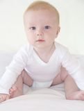 Cute little baby boy is sitting Royalty Free Stock Photography