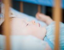 Baby boy is sleeping in the crib. Cute little Baby boy is sleeping in the crib Royalty Free Stock Photo