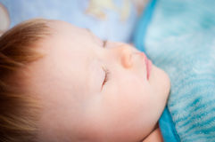 Baby boy is sleeping in the crib Royalty Free Stock Images