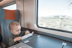 Cute little baby boy traveling by railway. Cute little boy traveling by railway. Young traveler royalty free stock images