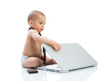Cute little baby businessman with computer Stock Photography