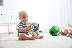 Cute little baby on carpet. Crawling time stock images