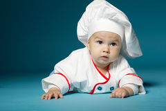 Cute little baby with chef hat. Photo of cute little baby with chef hat Stock Photo
