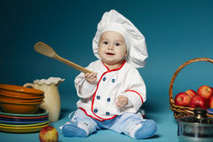 Cute little baby with chef hat. Photo of cute little baby with chef hat Royalty Free Stock Photos