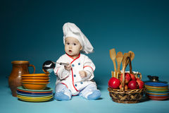 Cute little baby with chef hat Royalty Free Stock Photos