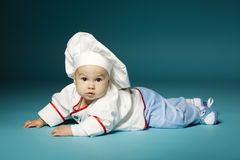 Cute little baby with chef hat Stock Photography