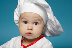 Cute little baby with chef hat. Photo of cute little baby with chef hat Stock Photos