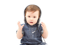 Cute little baby child in headphones Stock Images
