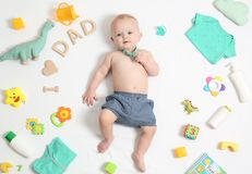 Cute little baby with clothing and accessories on white background stock photos