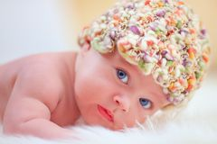 Cute little baby in colorful hat. Portrait of cute little baby in colorful hat stock image