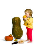 Cute little baby with colorful pumpkins Stock Photo