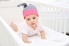 Cute little baby in cradle at home Stock Photos