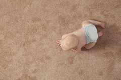 Cute little baby crawling on carpet indoors, with space for text. Cute little baby crawling on carpet indoors, top view with space for text stock photography