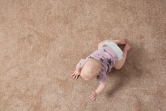 Cute little baby crawling on carpet indoors, with space for text. Cute little baby crawling on carpet indoors, top view with space for text royalty free stock image