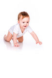 Cute little baby crawling Stock Photos