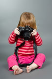 Cute little baby with digital photo camera Royalty Free Stock Images