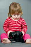 Cute little baby with digital photo camera Royalty Free Stock Photos