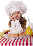 Cute little baby dressed as a cook Stock Photos