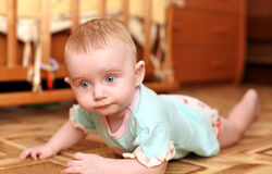 Baby on the Floor Royalty Free Stock Image