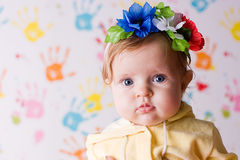 Cute little baby with flowers Royalty Free Stock Images