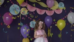 Cute little baby girl aroud confetti and decorations on her birthday party stock video