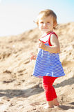 Cute little baby girl on the beach stock images