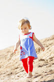 Cute little baby girl on the beach stock photo
