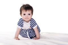Little baby girl crawling on floor, isolated on white royalty free stock photos