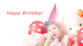 Cute little baby girl Celebrating her birthday. Surrounded with cake, Teddy bear doll,red balloons & hat isolated in white background Royalty Free Stock Images