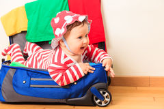 Cute little baby girl enjoy packing, kids travel Royalty Free Stock Images