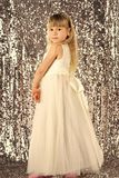 Cute little baby girl fashion pretty model blonde curly lady hair funny child birthday party fun children room. Decoration wear style clothes dress Stock Photos