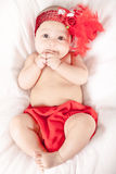 Cute little baby girl and flower red in her hair Royalty Free Stock Photography