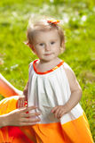 Cute little baby girl on grass in nature Royalty Free Stock Photography