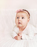 Cute little baby girl with pink flower headband exploring the wo Stock Image