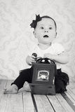 Cute little baby girl playing  with coffee grinder Royalty Free Stock Images