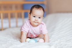 Cute little baby girl, playing with colorful easter eggs stock photography