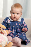 Cute little baby girl playing with her toys Stock Images
