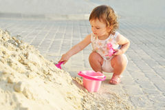 Cute little baby girl playing with sand in summer Royalty Free Stock Image