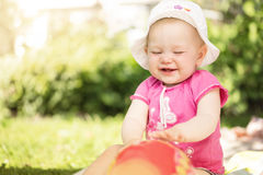 Cute little baby girl. Portrait of cute little baby girl playing ball in the garden with copy space Stock Photography