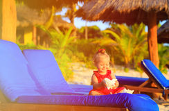 Cute little baby girl with seashells on tropical beach Stock Photography