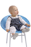 Cute little baby girl sitting in a chair Royalty Free Stock Image