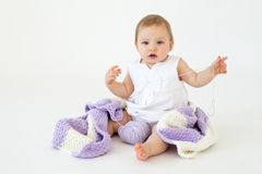 Cute little baby girl sitting on floor with plaid Stock Images