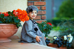 Cute little baby girl sitting on house porch steps royalty free stock photography