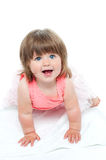 A cute little baby girl is staring up Royalty Free Stock Photo