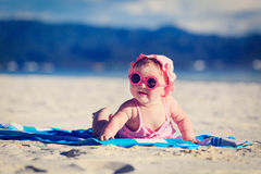 Cute little baby girl on tropical beach Royalty Free Stock Photos