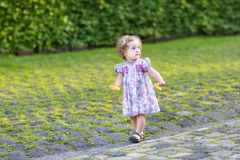 Cute little baby girl walking in the city Royalty Free Stock Photo