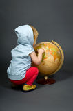 Cute little baby with globe Stock Photography